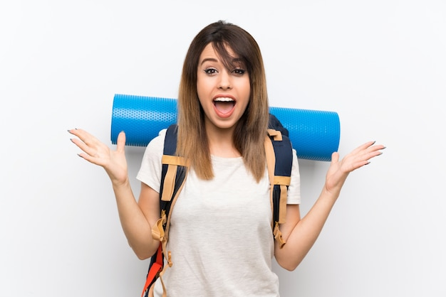 Young traveler woman over white background with shocked facial expression Premium Photo