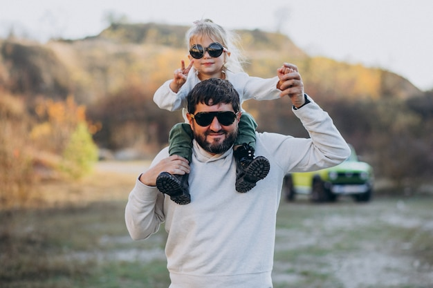Young trendy father with his little daughter sitting on shoulders Free Photo