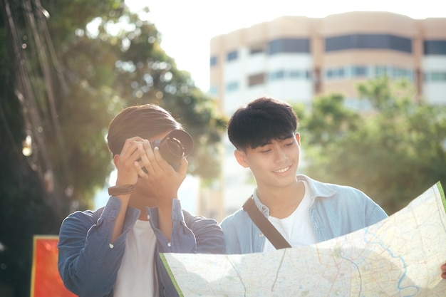 Young two men travel together in city on summer vacation. Premium Photo