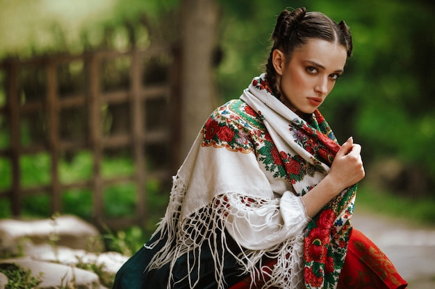 Young ukrainian girl in a colorful traditional dress Free Photo