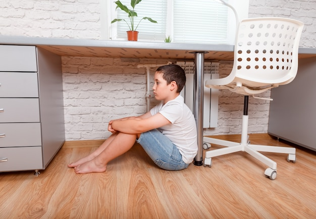 Young unhappy preteen sad boy at home. cyberbullying, teen problems Premium Photo