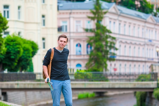 Young urban boy on vacation exploring city in europe Premium Photo