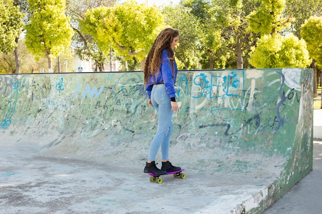 Young urban woman skating Free Photo