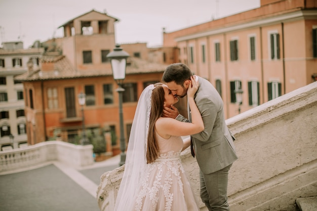 Young wedding couple on spanish stairs in rome, italy Premium Photo