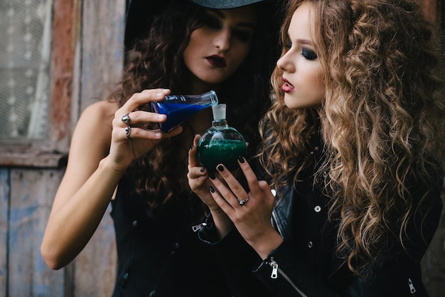 young witches mixing potions photo free download