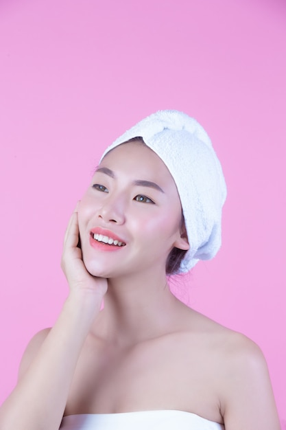 Young woman asia with clean fresh skin touch own face, expressive facial expressions, cosmetology and spa. Free Photo