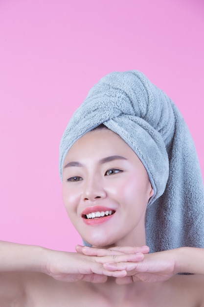 Young woman asia with clean fresh skin touch own face Free Photo