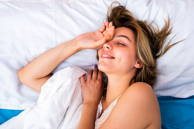 Young woman awaking in the morning Free Photo