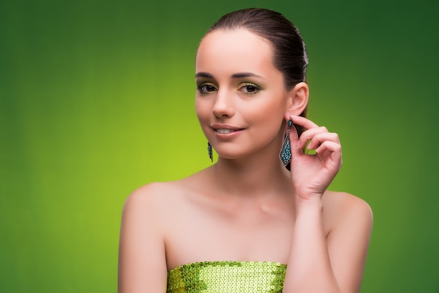 Young woman in beauty concept on green Premium Photo