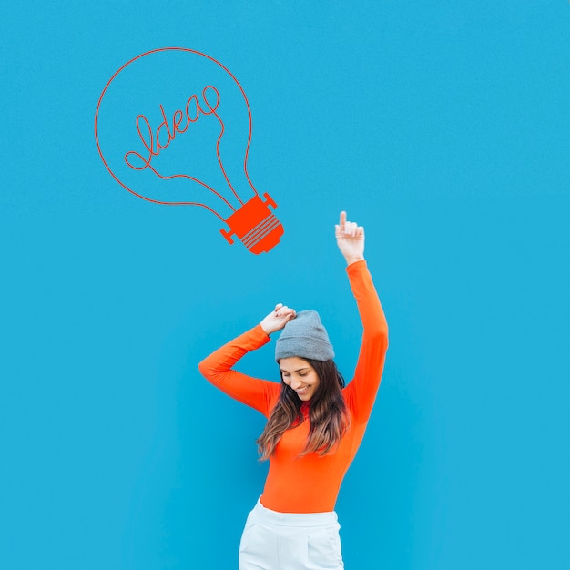 Young woman on blue background Free Photo