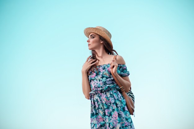 Young woman and blue sky Free Photo