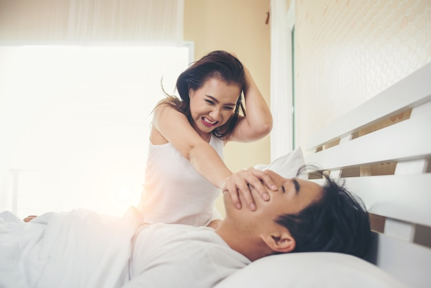 Young woman bored with her boyfriend snoring Free Photo