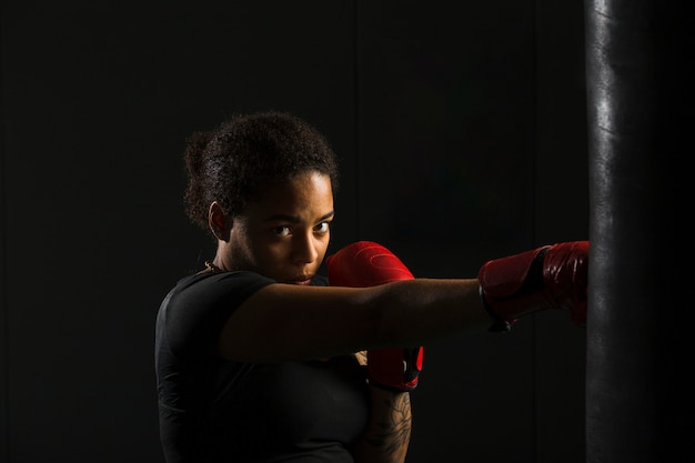 Young woman boxing in the gym Free Photo