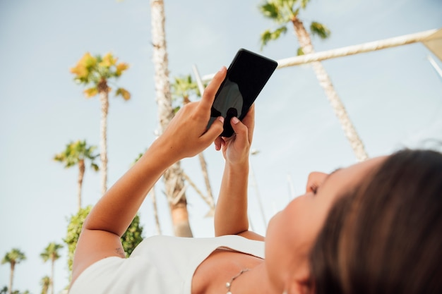 Young woman browsing on her phone Free Photo
