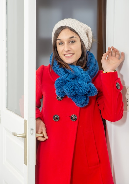 Young woman brunette woman with coat and winter cap Premium Photo