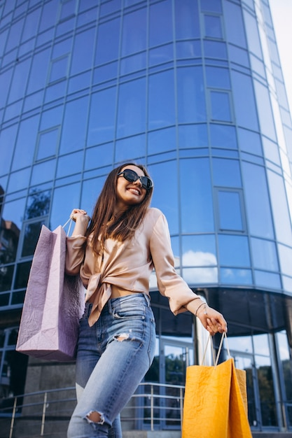 Young woman by the shopping center Free Photo