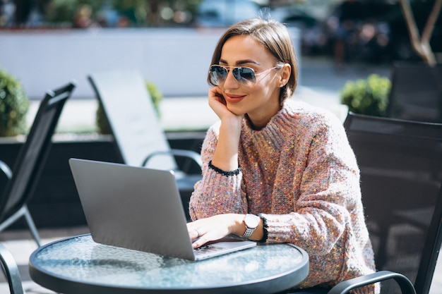 Young woman in a cafe using laptop Free Photo