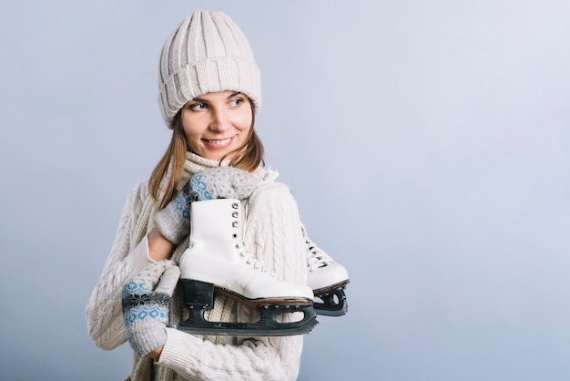 Young woman in cap with skates Free Photo