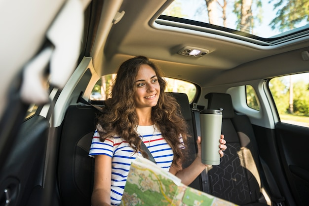 Young woman on a car trip Free Photo