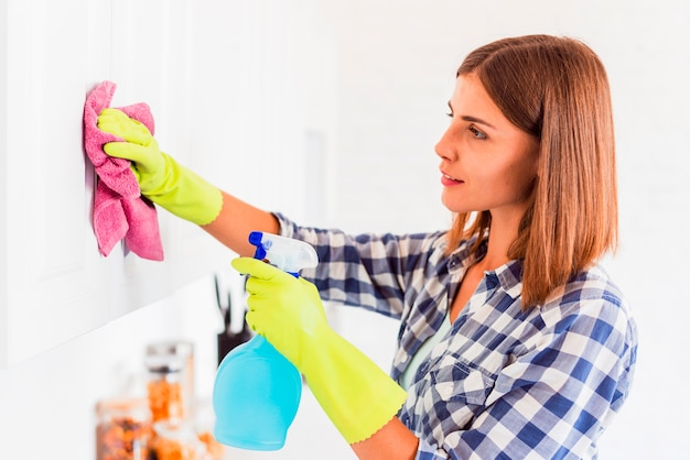Young woman cleaning the house Free Photo