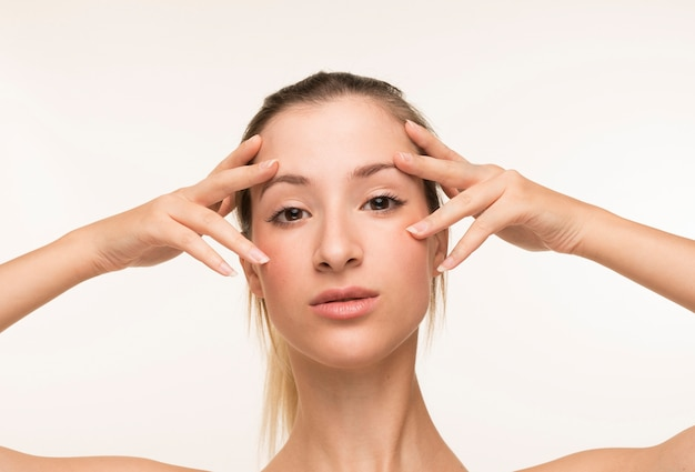 Young woman clear skin pose Free Photo