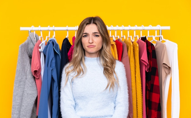 Young woman in a clothing store sad Premium Photo