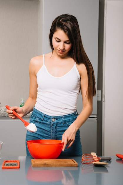 Young woman cooking in kitchen Free Photo