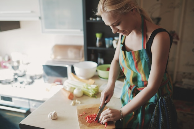 Young woman cutting vegetables Free Photo