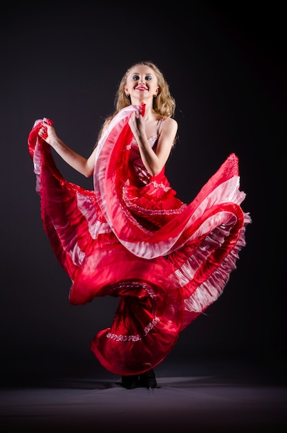 Young woman dancing in red dress Premium Photo