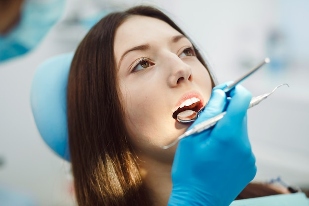 Young woman in a dental exam Free Photo