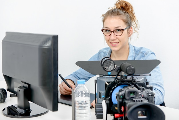 Young woman designer using graphics tablet for video editing Premium Photo
