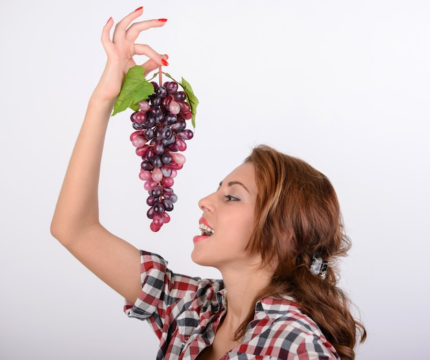 Young woman diet concept portrait with red grape Premium Photo