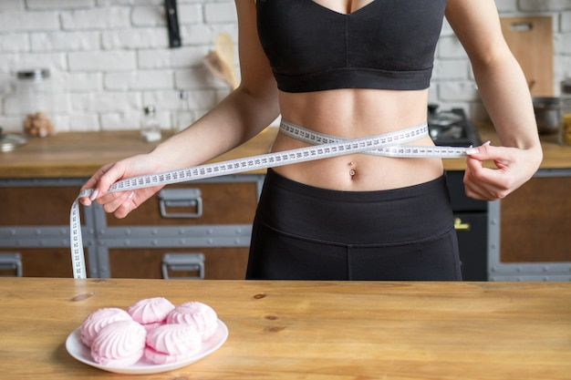 Young woman on a diet, woman stopped eating sweets to lose weight Premium Photo