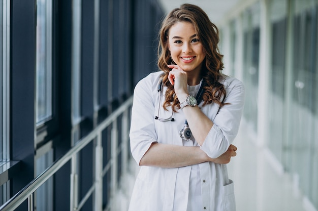 Young woman doctor with stethoscope at hospital Free Photo