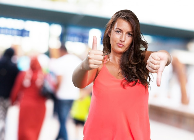 young woman doing a contradictory gesture Free Photo