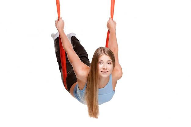 Young woman doing anti-gravity aerial yoga Free Photo