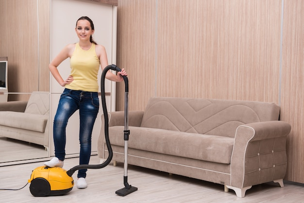 Young woman doing cleaning at home Premium Photo