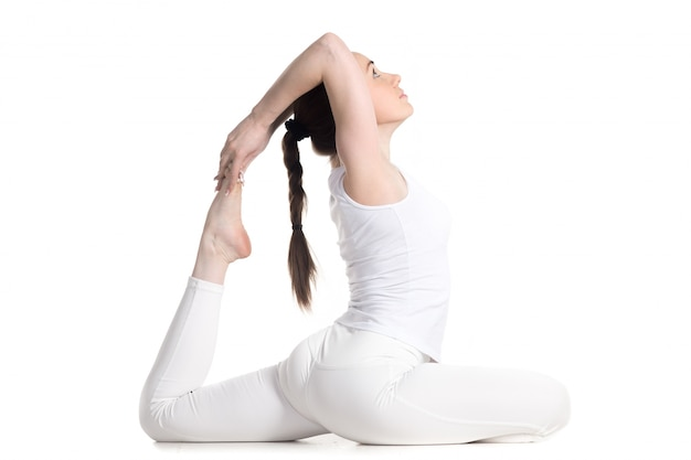 Young woman doing dove pose Free Photo