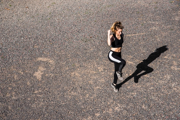 Young woman doing exercises at the street Free Photo