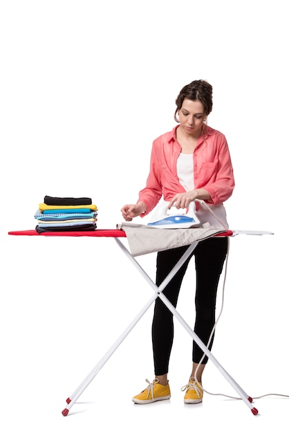 Young woman doing ironing isolated on white Premium Photo