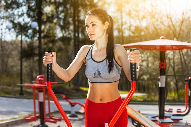 Young woman doing outdoors excercises Free Photo