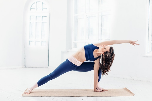 Young woman doing yoga exercises Free Photo
