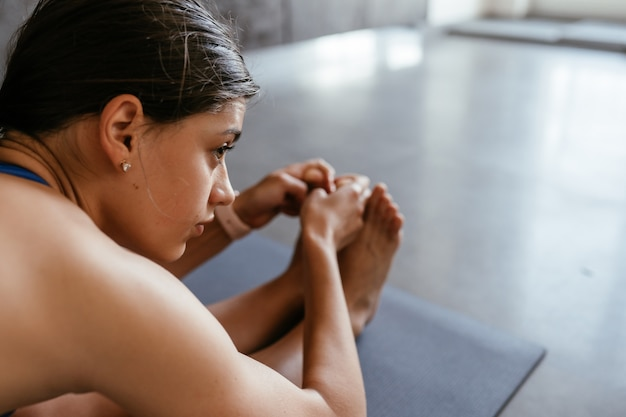 Young woman doing yoga pose exercise at home, healthy lifestyle Free Photo