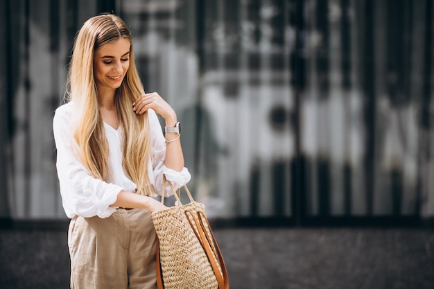 Young woman dressed in summer outfit out in the city Free Photo