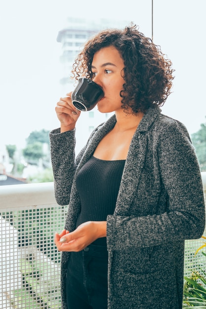 Young woman drinking coffee Free Photo