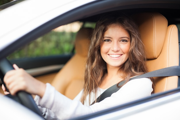 Young woman driving her car Premium Photo