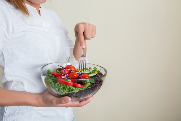 Young woman eating healthy salad Free Photo