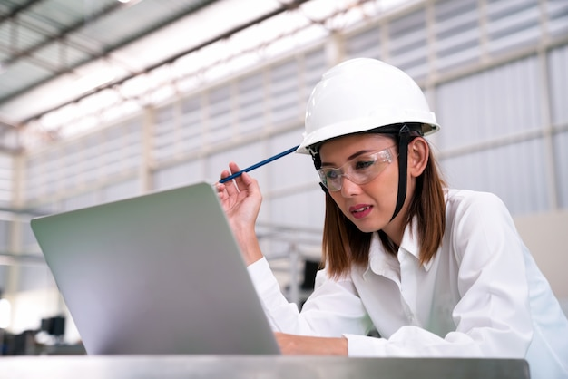 Young woman engineer working on robotics project, Premium Photo