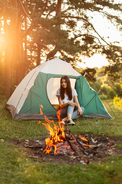 Young woman enjoying bonfire outdoors Free Photo