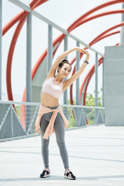 Young woman enjoying good stretch Free Photo